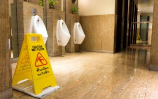Public restrooms with wet floors pose a risk for falls.